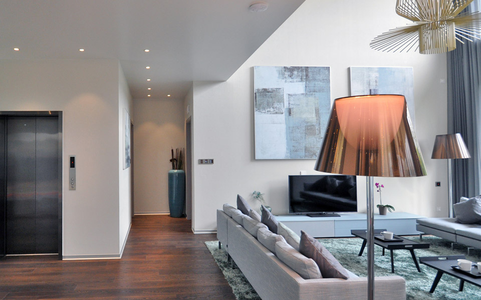 Musterwohnung Blick Wohnzimmer / Lift
